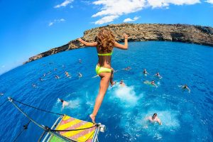 Girl jumping off a boat